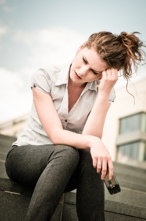 Bad message - unhappy woman with mobile phone Stock Photo - 17478398