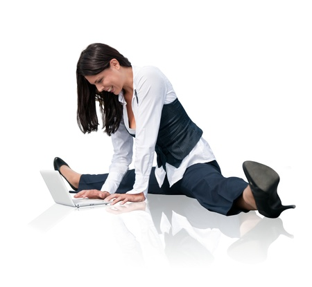 Flexible business woman with laptop Stock Photo - 17565223