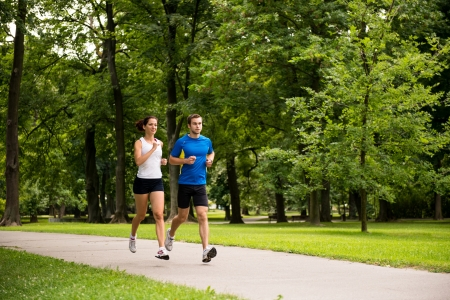 woman jogging: Jogging together - young couple running Stock Photo