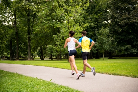 fit man: Jogging together - young couple running Stock Photo
