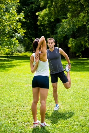 warm up: Warm up - couple exercising before jogging