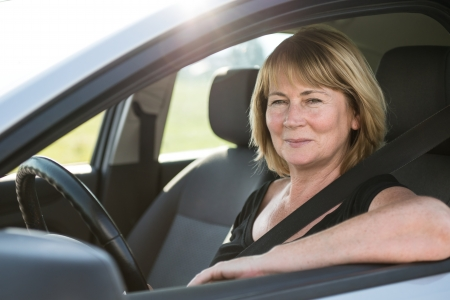 Portrait of senior woman in car photo