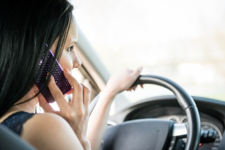 Calling phone while driving car Stock Photo
