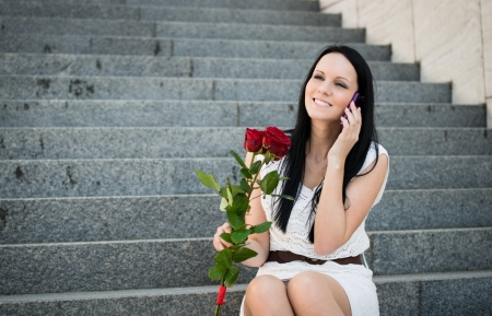 Happiness - woman with roses photo