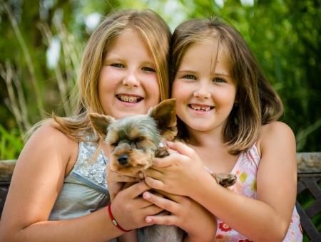 kids hugging: Happy children with their pet