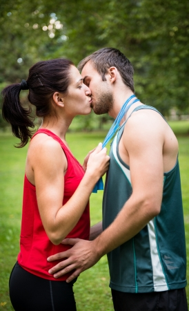 tenager: Young sport kissing couple