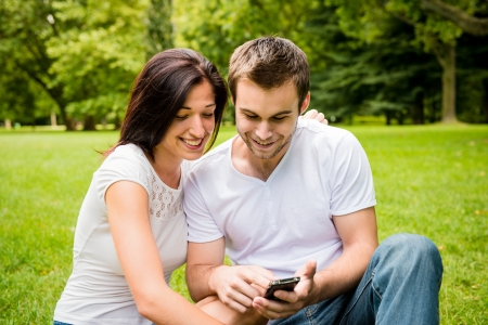 Young couple with smartphone Stock Photo - 21140215