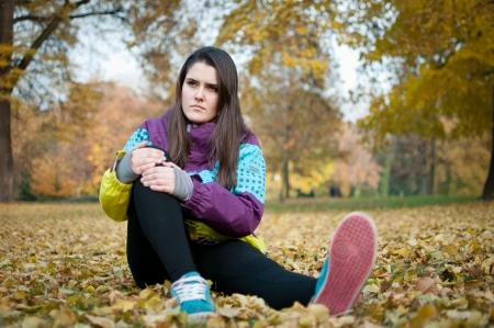 Knee injury - woman sitting in pain Stock Photo - 21140235