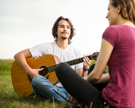 Playing guitar - romantic couple photo