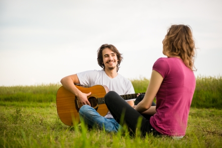 Playing guitar - dating couple photo