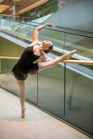 Ballet dancer at escalator photo