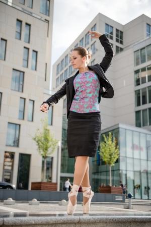Ballet dancer dancing on street photo