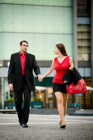 hurrying: Hurry - young business woman draging her boyfriend on street