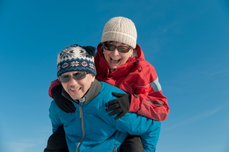 Active senior couple  - smiling mature man and woman outdoor in winter photo