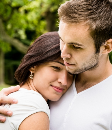 tenager: Romantic moments - young couple together, womans head laid on mens shoulder of man Stock Photo