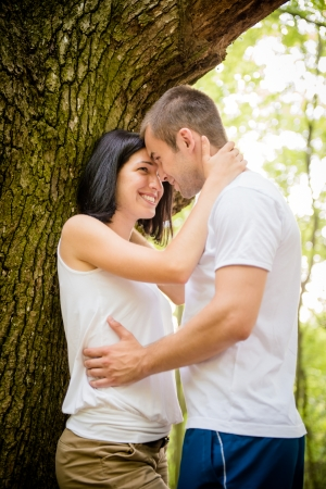 tenager: Young couple in love together in nature at tree