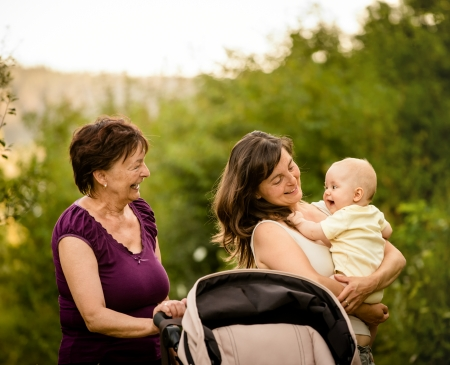 Happy together - grandmother with her daughter and her granddaughter outdoor in nature photo