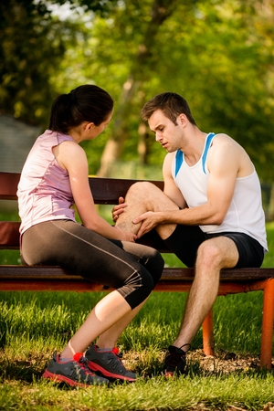 calf strain: Woman helps to man who injured his calf when jogging