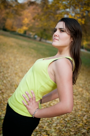 backpain: Backpain - sportswoman in pain Stock Photo