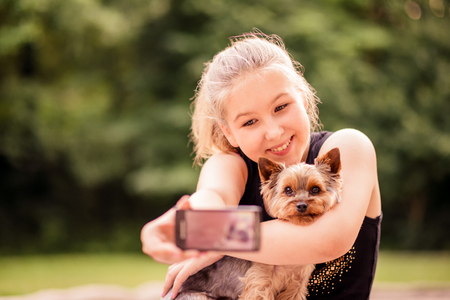 Selfie child and dog Stock Photo