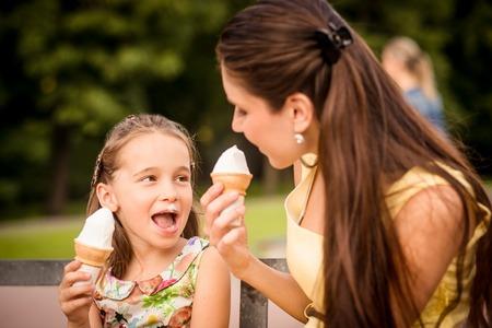 child ice cream: Mother and child enjoying icecream