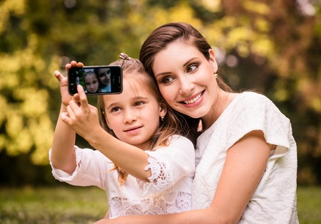 Mother with child selfie photo