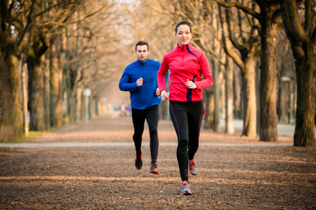 Couple jogging together photo