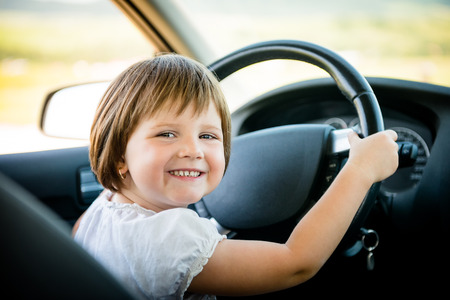 Child driving car Stock Photo