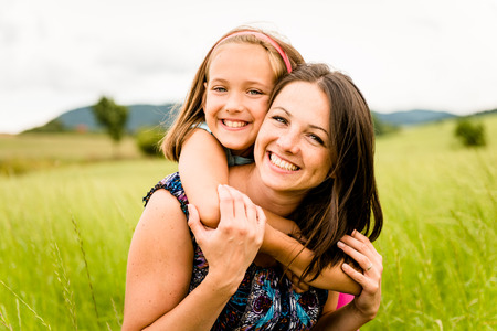 two girls hugging: Mother and child hugging Stock Photo