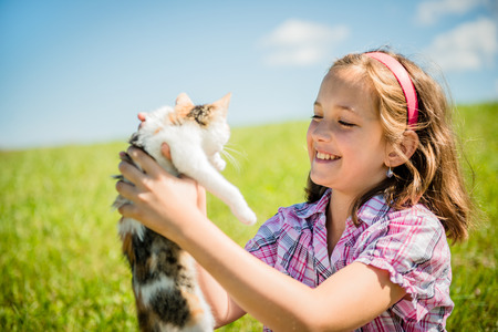 Child with cat photo