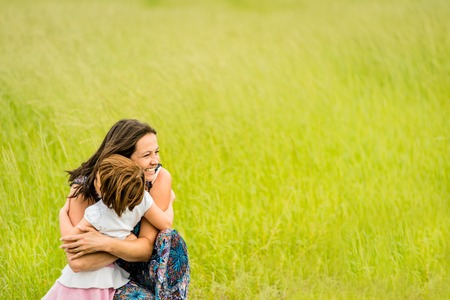 Mother and child embracing photo