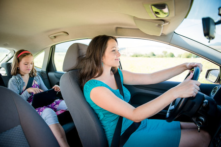 woman driving: Mother and child in car