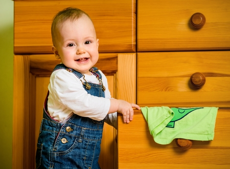 chest of drawers: Domestic chores - baby at drawer