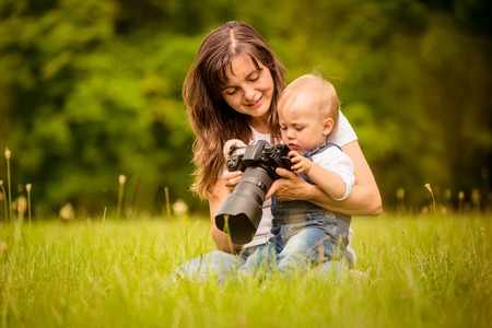 photographing: Mother, child and camera