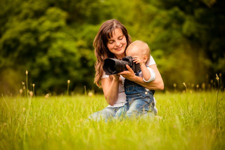 looking at camera: Mother, child and camera
