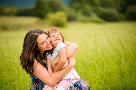 kids hugging: Mother and child hugging Stock Photo