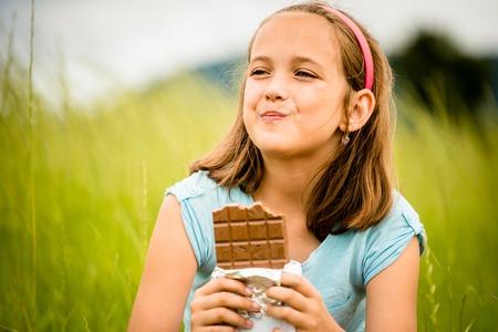 Girl enjoying chocolate photo