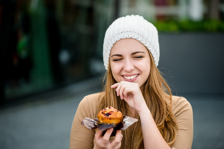 eating pastry: Teenager eating  muffin Stock Photo