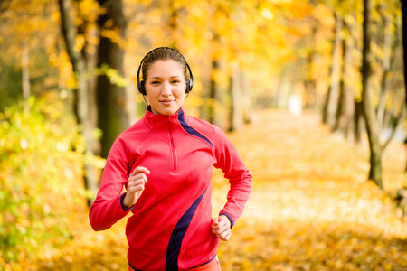 active listening: Woman running and listening music