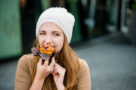 Teenager eating  muffin Stock Photo