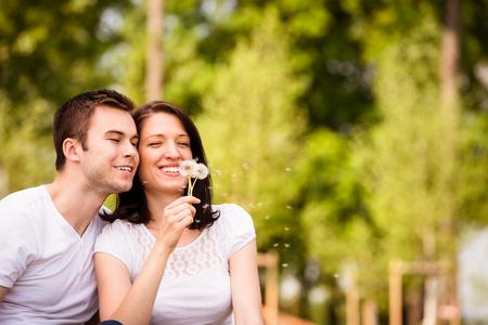 enjoying life: Enjoying life - couple blowing dandelions