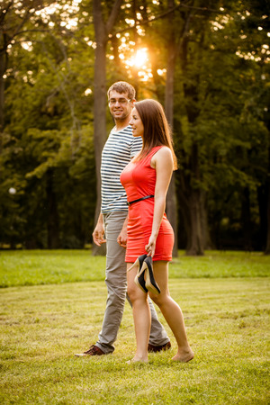 Young couple walking on grass photo