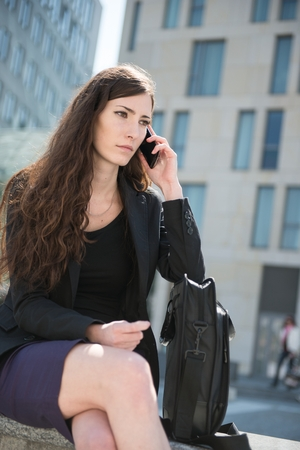 business woman phone: Business woman calling using phone