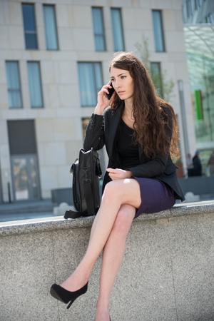 Business woman calling using phone photo