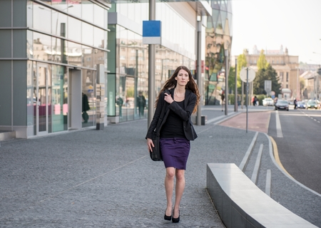 Business woman walking in hurry photo