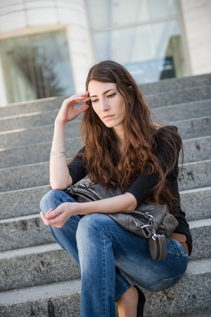 Problems - young woman outdoor portrait photo