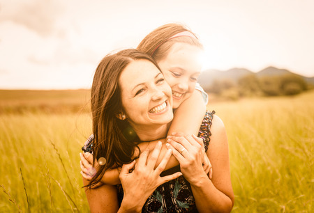 child: Mother and child hugging Stock Photo