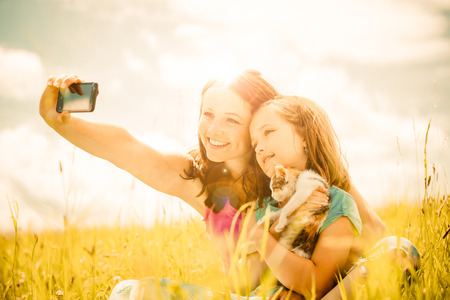 animal pussy: Selfie - mother, child and kitten Stock Photo