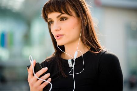 handsfree phones: Woman calling phone in street