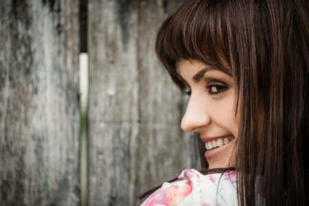 fade away: Woman portrait on wooden fence  Stock Photo